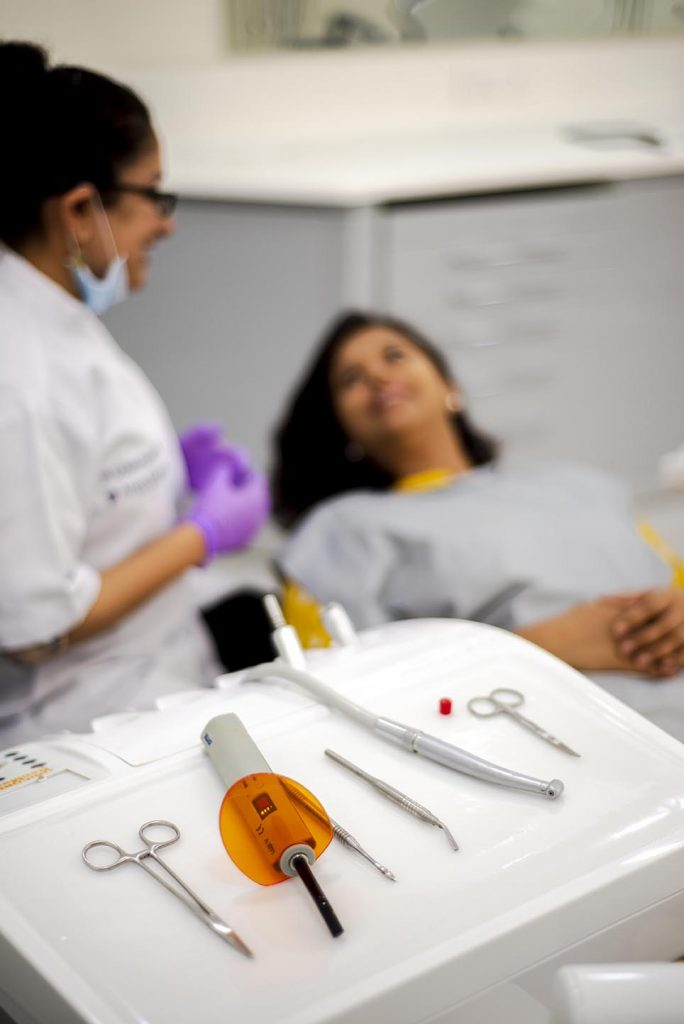 Best Dentist in Gurgaon with her Patient   Alveo Dental Clinic