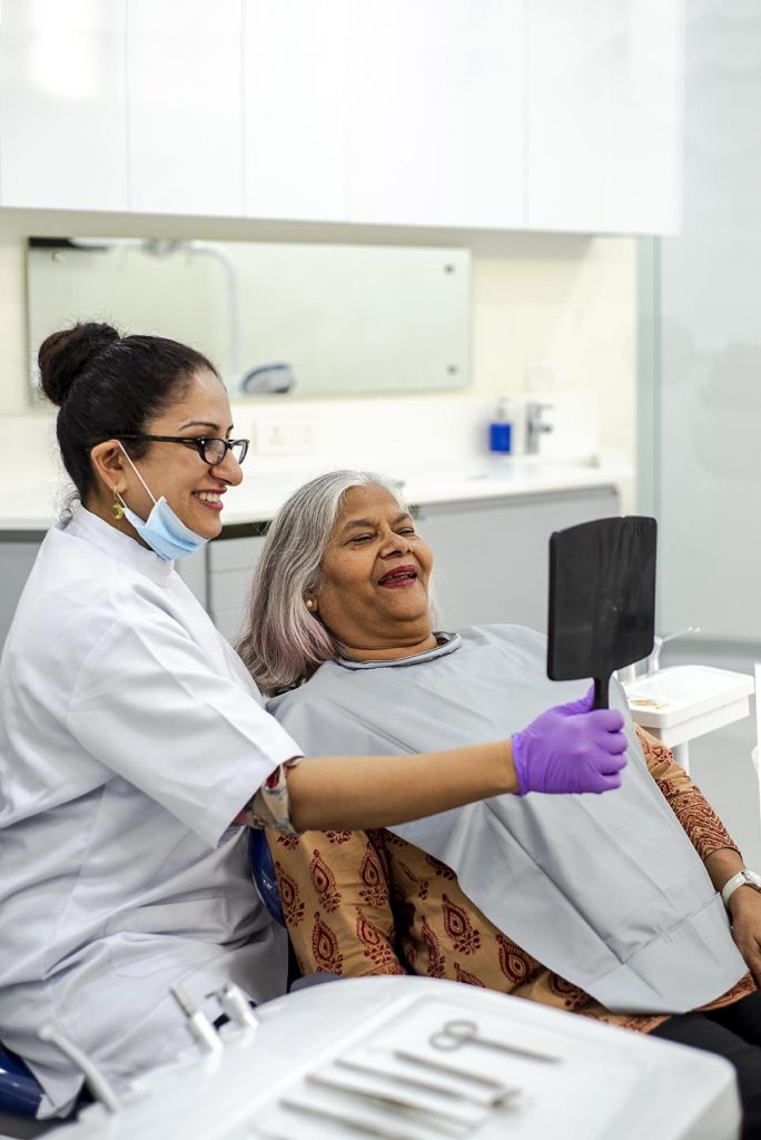 Best Cosmetic Dentist in Gurgaon with Old Lady   Alveo Dental Clinic